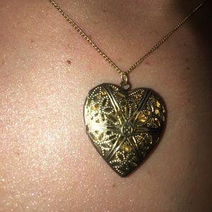 Delicate gold heart locket